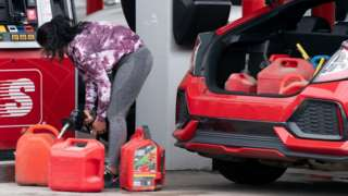 Woman filling up petrol cans in Benson, North Carolina, on Wednesday.
