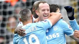 Charlie Adam is congratulated by his team-mates during Stoke City's win at Watford
