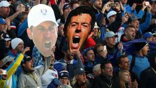 Fans with Rory McIlroy mask