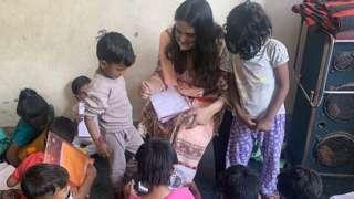 Devanshi with children