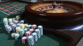 A computer generated image of a roulette table stacked with chips from the casino