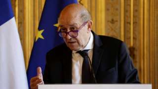 France's Minister for Foreign Affairs Jean-Yves Le Drian makes a statement