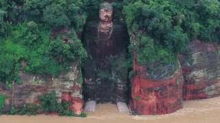 Giant Buddha surrounded by floods