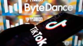 TikTok app on smartphone next to ByteDance logo