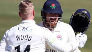 Danny Lamb celebrates with Luke Wood.