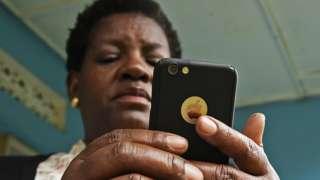 A woman on a mobile phone in Kampala, Uganda - 2018