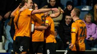 Hull City players celebrate their winner against QPR