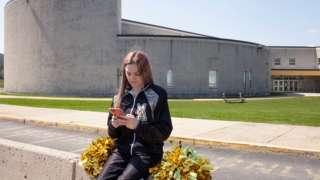 Brandi Levy outside the high school
