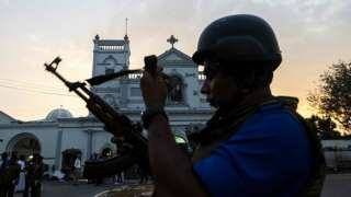 Soldiers stand guard in front of St Anthony's Shrine in Colombo on April 26, 2019