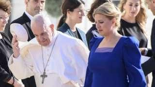 Slovak President Zuzana Caputova (R) welcomes Pope Francis at the Presidential Palace in Bratislava