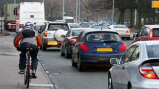 Early morning traffic builds up along the Princess Parkway into Manchester city centre.