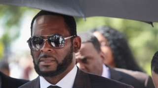 R Kelly outside court