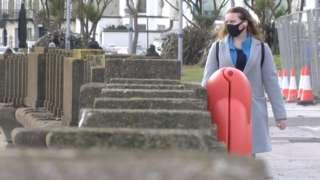 Woman walking along Douglas promenade