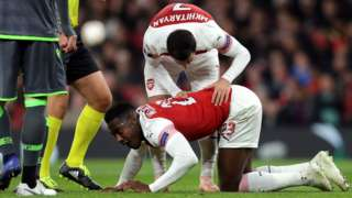Arsenal's Danny Welbeck is injured against Sporting Lisbon