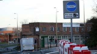 A road sign warning motorists of a bus lane camera