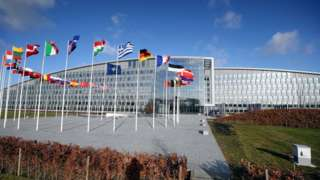Flags outside the Nato headquarters in Brussels