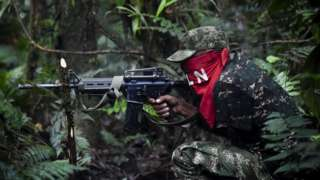 Members of the Ernesto Che Guevara front, belonging to the National Liberation Army (ELN) guerrillas, shoot during a training in the jungle, in Choco department in Colombia, on May 26, 2019