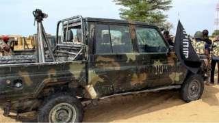 A vehicle carrying Boko Haram flag