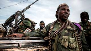 Soldiers of the Armed Forces of the Democratic Republic of the Congo (FARDC) sit in a truck bed in a base on July 3, 2019