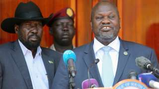 Former rebel leader Riek Machar (r)flanked by President Salva Kiir address a news conference at the State House in Juba, South Sudan February 20, 2020