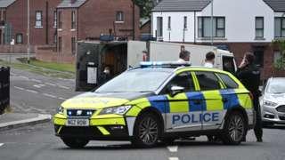 Police attend the scene of Glenavy security alert
