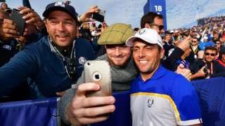 Francesco Molinari and a fan