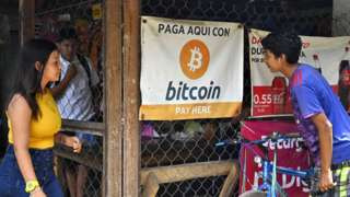 People are seen in a store where bitcoins are accepted in El Zonte, La Libertad, El Salvador on 4 September 2021