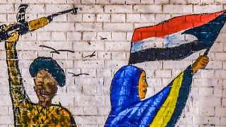 Lukisan prajurit Sudan dan demontsran perempuan