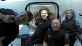 Jared Isaacman, Sian Proctor, Hayley Arceneaux, and Chris Sembroski, seen on their first day in space in this handout photo released on September 17, 2021.