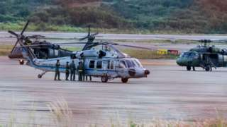 The Colombian president's helicopter sits on the runway after it is hit by gunfire, June 2021