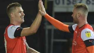 Luton's James Collins celebrates a goal