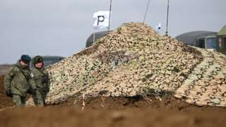 A camouflage net covers military hardware during an exercise held by units of the Novorossiysk guards mountain air assault division of the Russian Airborne Troops at Opuk range
