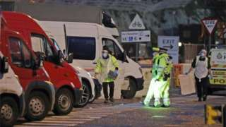Testers prepare to take samples from drivers parked in the Port of Dover in Kent