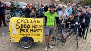 Josh Garman finishing his found-Britain cycle ride