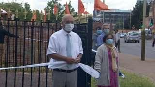 People standing around Gandhi statue