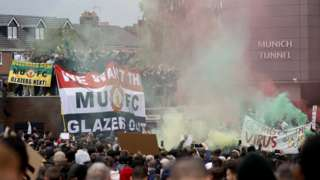 Manchester United fans protest outside Old Trafford against the club's ownership under the Glazer family