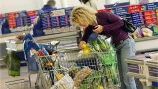 Woman looking in trolley
