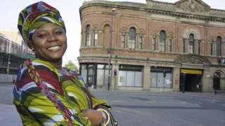 Woman wey dey smile for UK