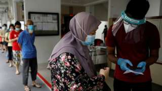 Residents of a public housing estate queue up for mandatory coronavirus swab tests in Singapore May 21, 2021