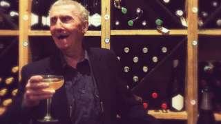 Boyne Lester Johnston enjoying champagne in the former bank vault