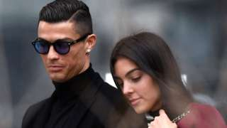 Juventus' forward and former Real Madrid player Cristiano Ronaldo leaves with his Spanish girlfriend Georgina Rodriguez