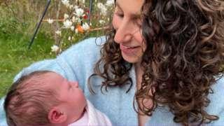 Victoria White with her newborn daughter