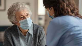 Stock image of an elderly woman with a care worker