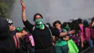 Woman gestures as participants mark International Women's Day in Mexico City8 March 2020