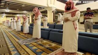 Muslims perform prayers inside the Al-Rajhi Mosque while practicing social distancing in Saudi Arabia