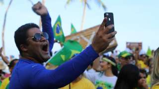 A supporter of Jair Bolsonaro takes a selfie at a rally