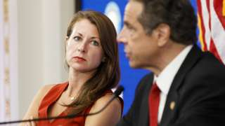 Melissa DeRosa (L), Secretary to New York Governor Andrew Cuomo, listens as Cuomo speaks during his daily briefing in a conference room at the New York Stock Exchange in New York, New York, USA, on 26 May 2020.