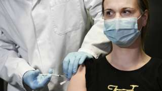 A doctor in the Netherlands receives the Pfizer vaccination