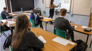 Students following social distancing rules in a language class