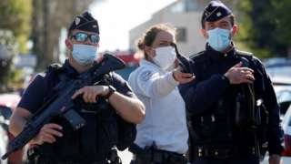 Police officers secure the area where an attacker stabbed a female police administrative worker, in Rambouillet, near Paris, France, April 23,